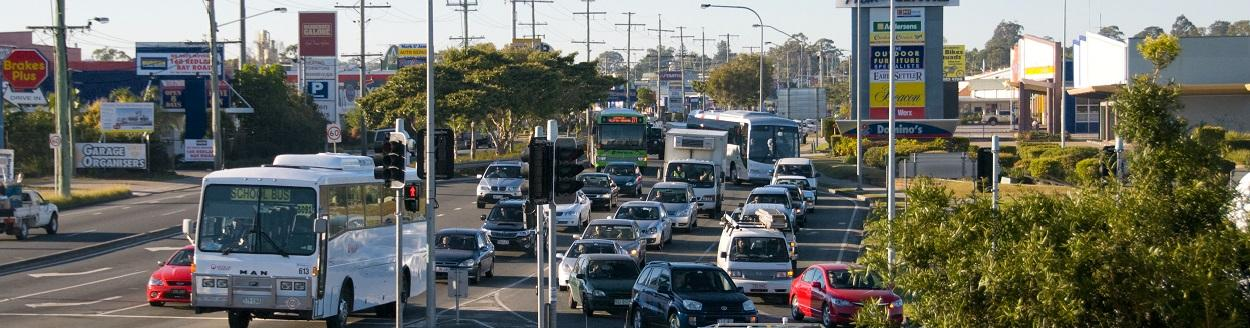 Busy road in Capalaba with cars, buses and trucks